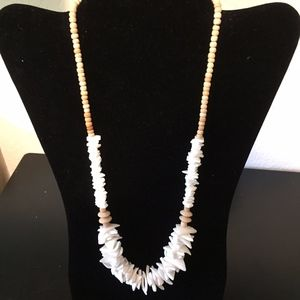 Awesome shell Necklace. Add this to your bundle!